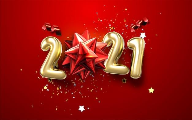 Año nuevo fondo cretativo tipográfico 2021 con arco de navidad, números metálicos antiguos 2021