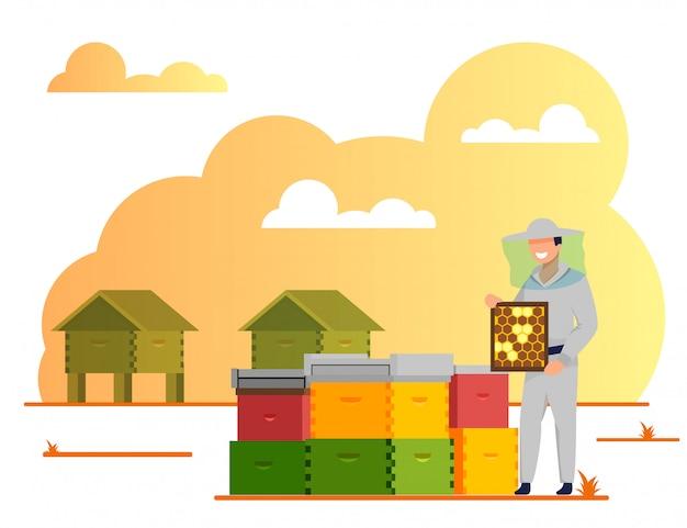 Apicultor trabajando en colmenar, industria apícola