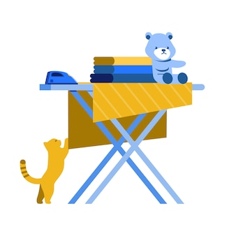 Apilar la ropa en la tabla de planchar sobre fondo blanco.