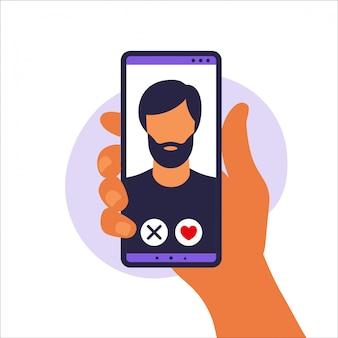 Aplicación de citas. aplicación de citas móvil para encontrar nuevos amigos, conexiones y parejas románticas. ilustración de la mano humana que sostiene smartphone con foto hombre. ilustración en piso.