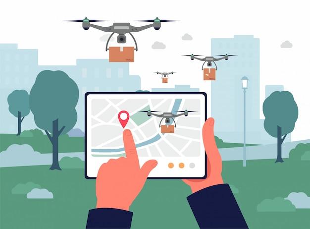 Aplicación de control remoto de drones de entrega en la pantalla de la tableta, dispositivo de sujeción de manos