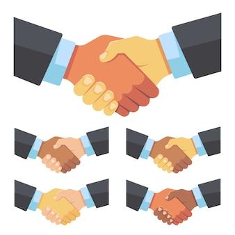 Apretón de manos de empresarios de diferentes razas.
