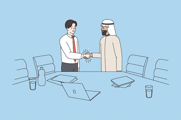 Apretón de manos de empresarios multiétnicos en oficina hacen acuerdo