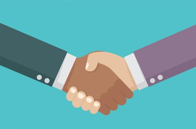 Apretón de manos de los socios comerciales.