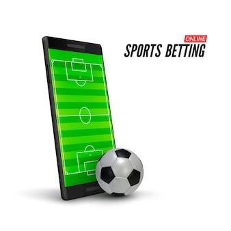 Apuestas deportivas online. teléfono móvil con campo de fútbol en pantalla y pelota de fútbol realista en el frente.