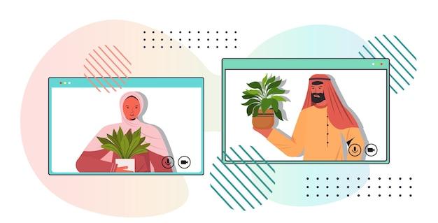 Los árabes cuidando de las plantas de interior amas de casa árabes discutiendo durante la videollamada en el navegador web horizontal vertical de windows