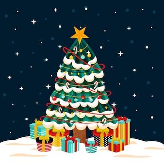 Árbol de navidad con regalos en la noche.