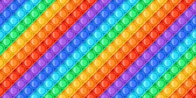 Arco iris de dibujos animados pop-it juguete burbujas de patrones sin fisuras. juguetes de empuje sensoriales antiestrés. textura de vector colorido juego de relajación de moda pop fidget. entretenimiento brillante o pasatiempo para aliviar el estrés