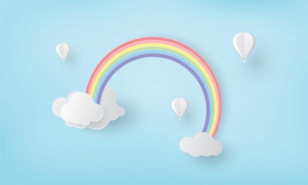 Arco iris en la nube con globo, temporada de lluvias
