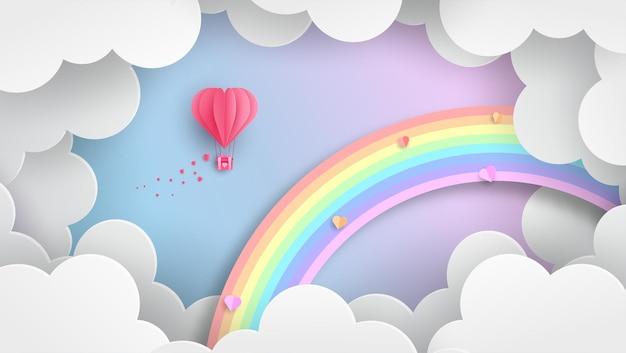 Arco iris y nubes con estilo papercut.
