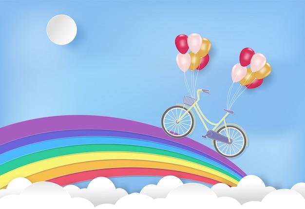 Arcoiris con bicicleta y globos.