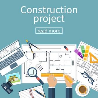 Arquitecto manos dibujando una bandera de proyecto de construcción de planos