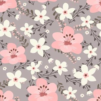Arte floral para prendas de vestir y telas de moda, guirnalda de flores rosadas estilo hiedra con rama y hojas. patrones sin fisuras de fondo.