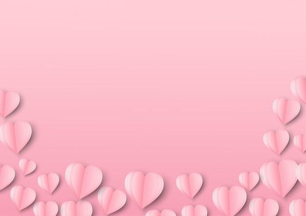 Arte de papel de amor y origami hecho forma de corazón en rosa pastel volando