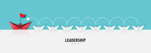 Arte de papel del concepto de liderazgo con barco de origami en el fondo del río