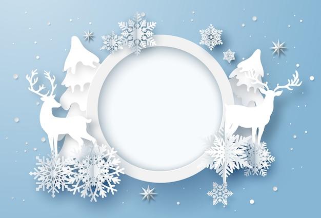 Arte en papel de tarjeta de vacaciones de invierno con copos de nieve y renos