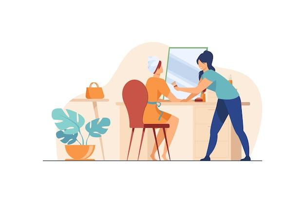 Artista de maquillaje trabajando en mujer