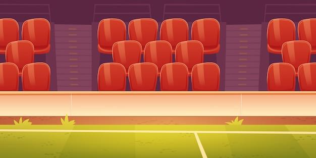 Asientos de plástico rojo en la tribuna del estadio deportivo