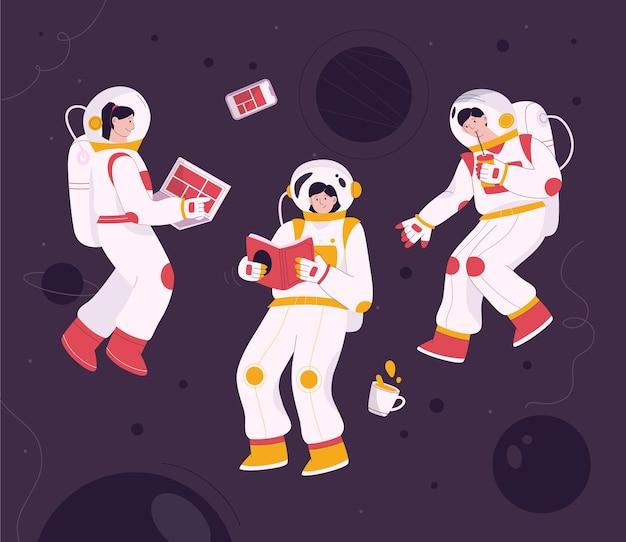 Astronautas volando en gravedad cero en el espacio.