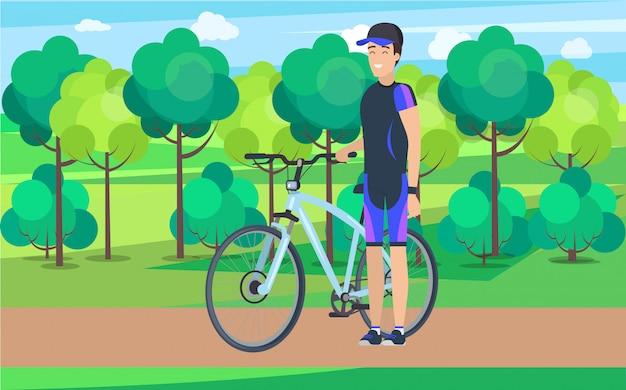 Atleta alegre en pista con bicicleta