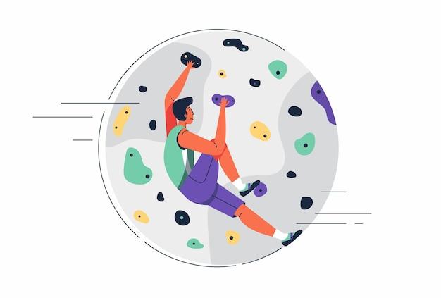 Atleta entrenamiento de escalada en roca con agarraderas en la práctica de rocódromo para preparar la competencia olímpica