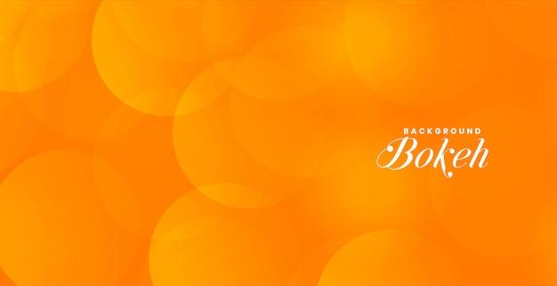 Atractivo banner bokeh naranja con espacio de texto