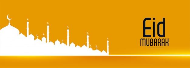 Atractivo banner del festival eid con silueta de mezquita