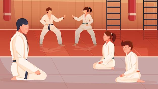 Aula de artes marciales con entrenador y niños haciendo ejercicios.