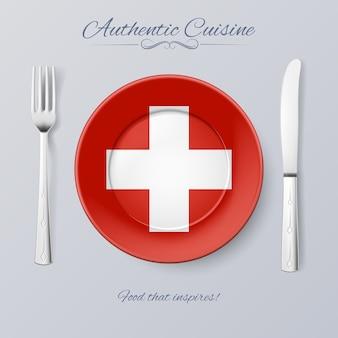 Auténtica cocina de suiza. plato con bandera suiza y cubiertos