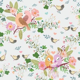 Aves y flores en el bosque de patrones sin fisuras.
