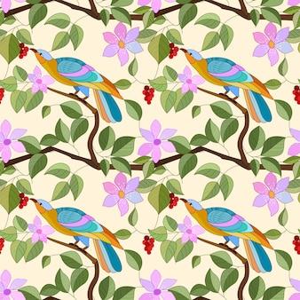 Aves en rama con flores de patrones sin fisuras.
