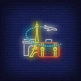 Avión, maleta, torre eiffel y señal de neón del arco del triunfo.