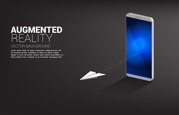 Avión de papel origami volando desde el teléfono móvil. concepto de tecnología de realidad aumentada.