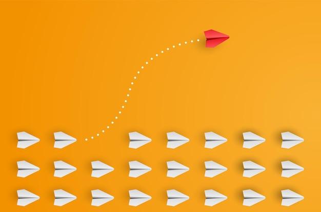 El avión de papel rojo líder individual y único vuela hacia un lado. concepto de individualidad. piensa diferente. ilustración vectorial
