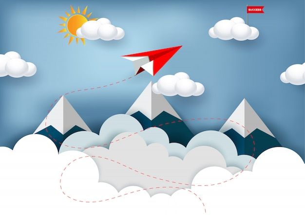 El avión de papel rojo está volando hacia el objetivo de la bandera roja en la nube mientras vuela por encima de las montañas.