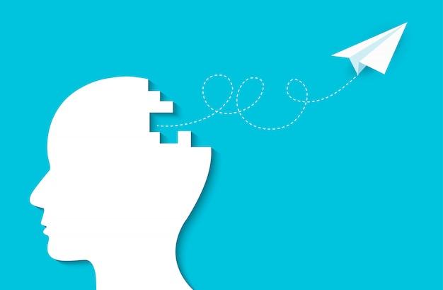 Avión de papel volando de la cabeza humana, idea creativa, éxito en los negocios