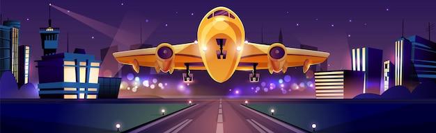 Avión de pasajeros o carga que despega o aterriza en la pista durante la noche, luces de la ciudad