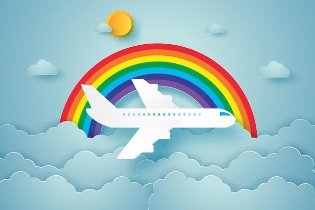 Avión volando en el cielo con arco iris en estilo de arte de papel