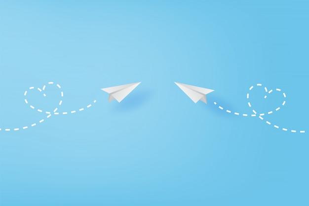Aviones de papel blanco volando concepto de corazón