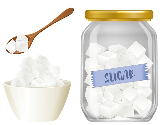 Azúcar de cubo en el fondo blanco