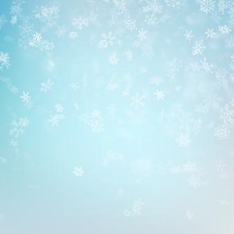 Azul borrosa banner de invierno con copos de nieve.