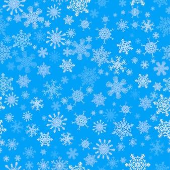 Azul sin patrón de navidad con diferentes copos de nieve