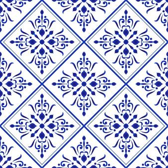 Azulejo de cerámica patrón azul y blanco damasco y estilo barroco.