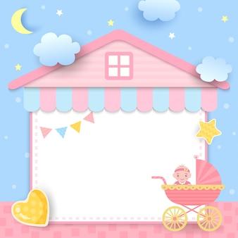 Baby shower con cochecito y marco de la casa.