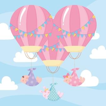 Baby shower, lindos bebés volando en globos aerostáticos, celebración bienvenido recién nacido