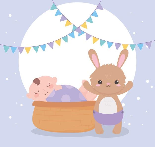 Baby shower, niño en canasta y conejito con pañal, celebración bienvenido recién nacido