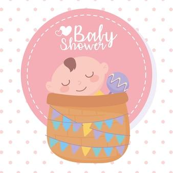 Baby shower, niño en canasta con sonajero, celebración bienvenido recién nacido