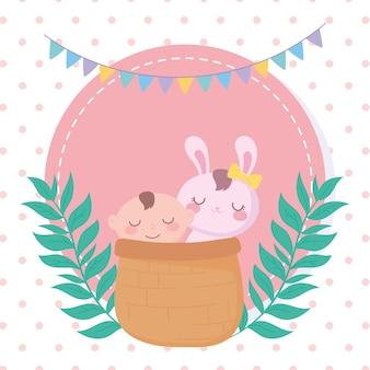 Baby shower, niño y conejo en canasta, celebración bienvenida recién nacido