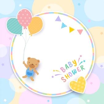 Baby shower con oso sosteniendo globos y marco de círculo