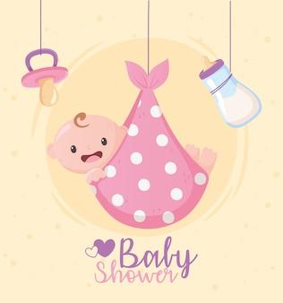 Baby shower, tarjeta de felicitación colgando chupete de niño pequeño y botella de leche